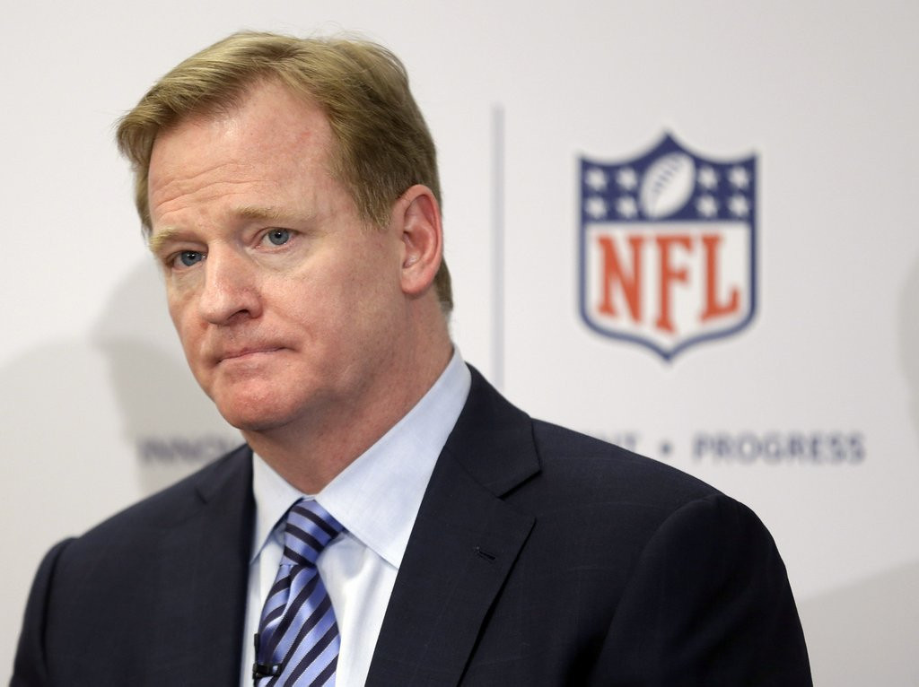 """. <p><b> NFL Commissioner Roger Goodell has made it clear that he is interested in getting these out of the league forever � </b> <p> A. Extra-point kicks <p> B. Two-point conversions <p> C. Advocates for same-sex marriage <p><b><a href=\'http://www.nytimes.com/2014/01/22/sports/football/nfl-roundup.html?_r=0\' target=\""""_blank\"""">HUH?</a></b> <p>   (AP Photo/Seth Wenig, File)"""