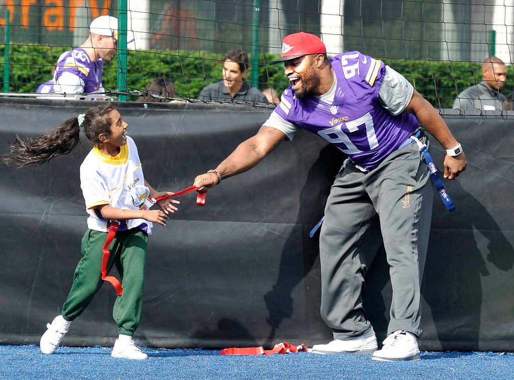 . Vikings defensive end Everson Griffen plays tag during a football clinic at Wembley Stadium Tuesday. (NFL: Sean Ryan)