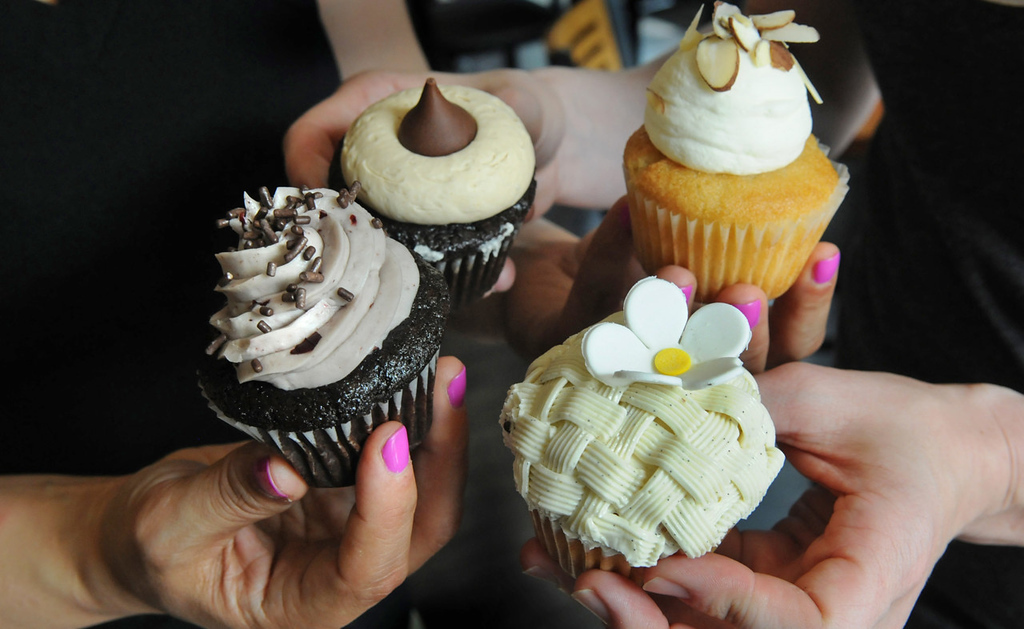 . Cupcakes are among the many baked delights available at the Buttered Tin, a new bakery and cafe in St. Paul\'s Lowertown. A sampling includes (clockwise, from left) Black Cherry, Peanut Butter Blossom, Almond Kiss and Fancy Nancy, all photographed at the cafe Thursday, July 25, 2013. (Pioneer Press: Jean Pieri)
