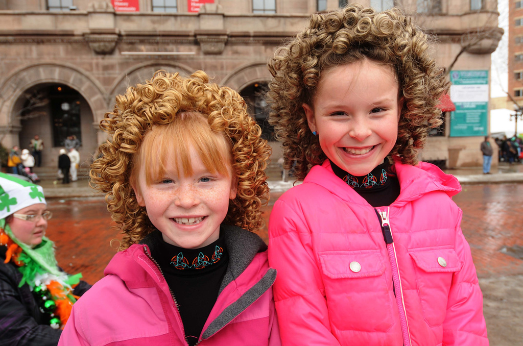 . Seven-year-old Molly Virnig, left, and her nine-year-old sister Lucy, both of Maple Grove, went against type with pink outfits outside the Landmark Center, where they had earlier performed an Irish dance show with the Eilis Academy at Escalate, during the annual St. Patrick\'s Day parade.  (Pioneer Press: Scott Takushi)