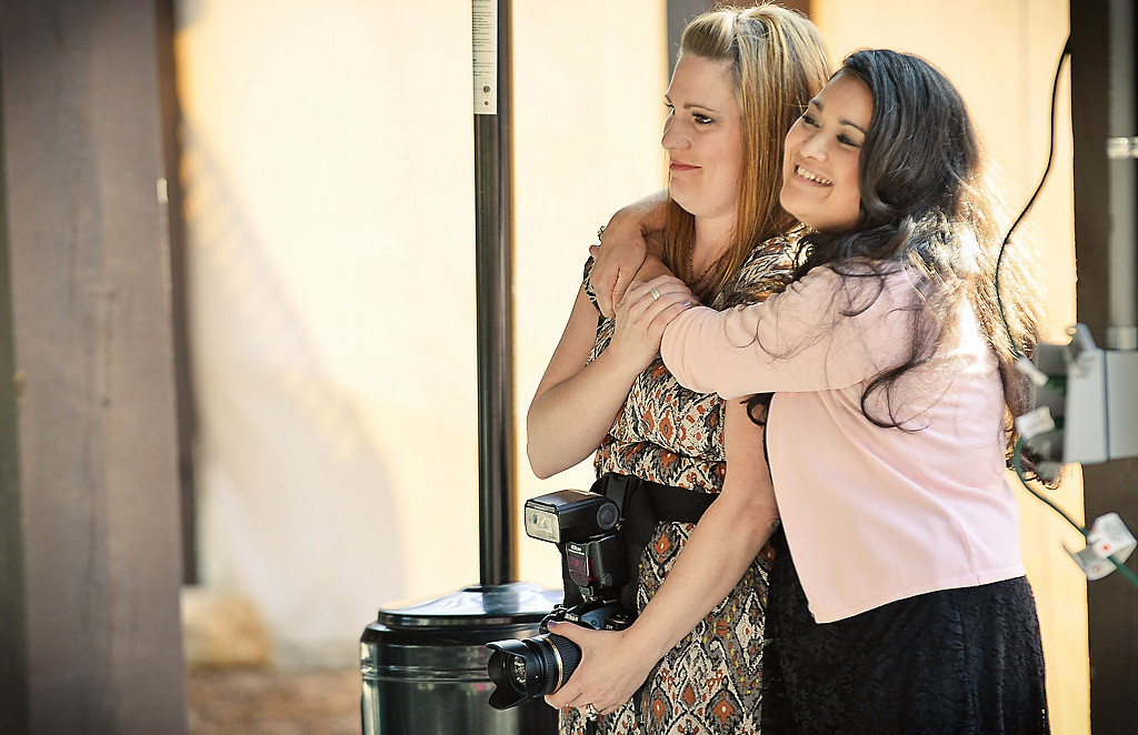 . Fairy Godmother Project Minnesota co-founders Amy Coppersmith, left, and Terri Uy-Lennon watch the wedding. (Pioneer Press: Ben Garvin)