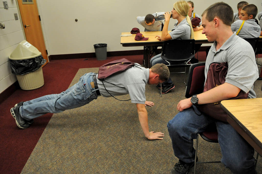. Cadet Isaac Holm does pushups for not following the chain of command. Holm said that he asked the wrong person if he could wash his hands. (Pioneer Press: Jean Pieri)