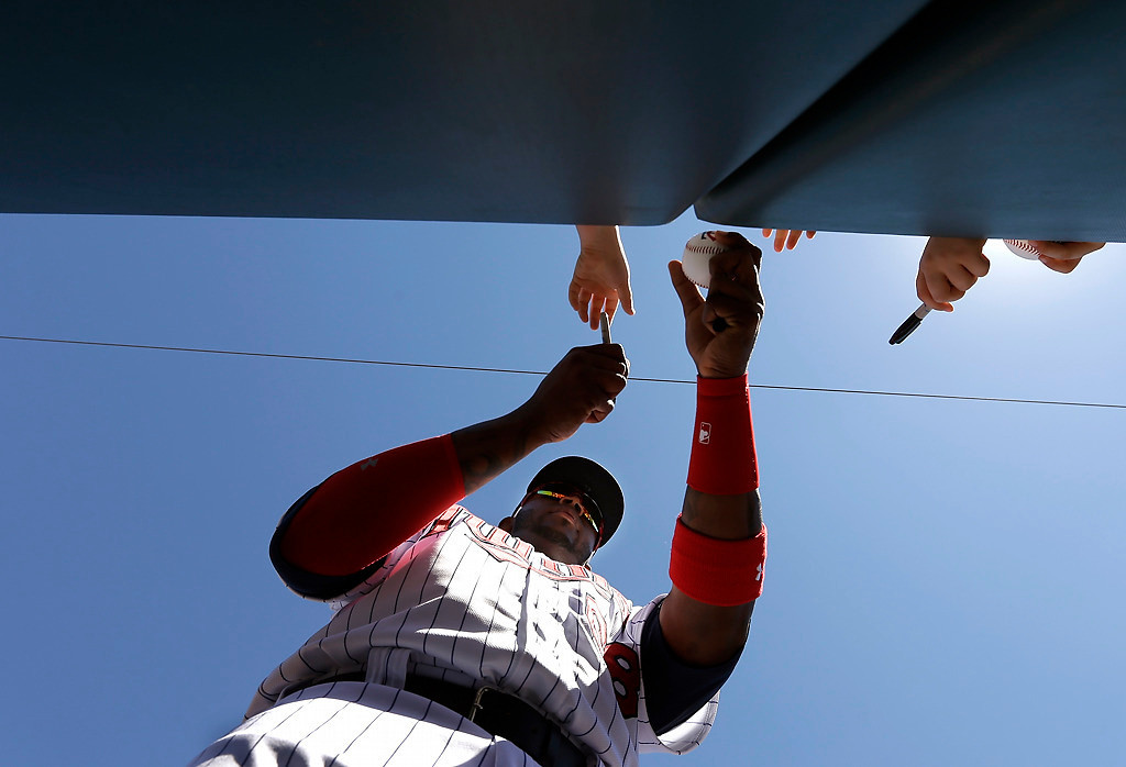 . Minnesota Twins first baseman Kennys Vargas signs autographs for fans before an exhibition baseball game against the Boston Red Sox, Saturday, March 1, 2014, in Fort Myers, Fla. (AP Photo/Steven Senne)