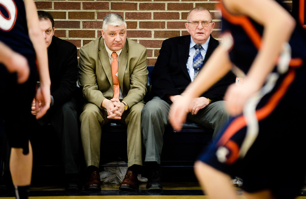 . Chisholm boys basketball coach Bob McDonald, right, and assistant coach Larry Pervenanze watch as their players nearly double their score over Nashwauk-Keewatin. McDonald recently won his 1,000th game and is retiring after this season, and Pervenanze will become the new head coach.  (Pioneer Press: Ben Garvin)