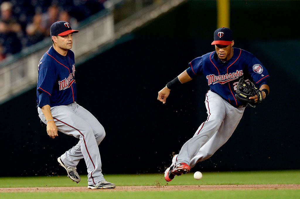 . Jamey Carroll #8 of the Minnesota Twins is unable to catch a ball hit by Ryan Zimmerman #11 of the Washington Nationals in the fifth inning. (Photo by Patrick McDermott/Getty Images)