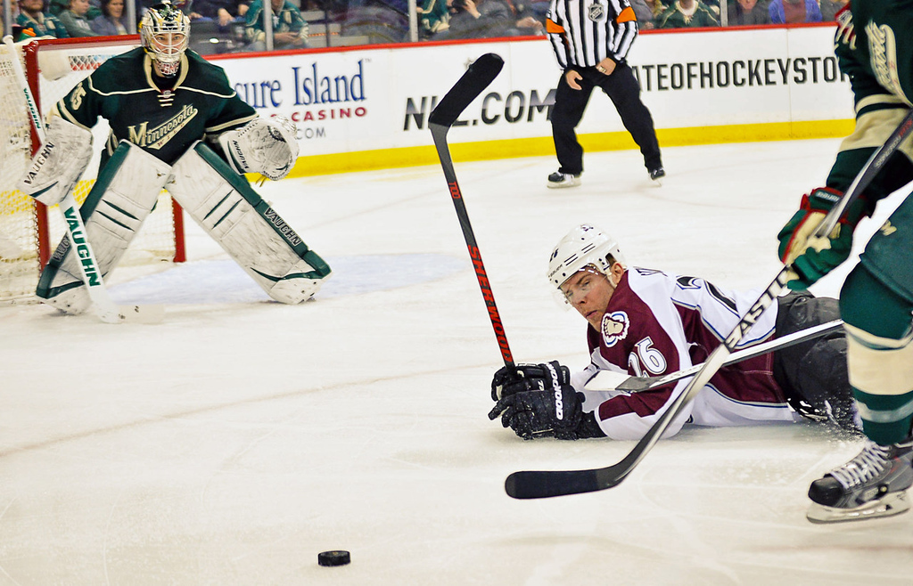 . Avalanche center Paul Stastny falls to the ice while pursuing the puck against the Wild in the first period.  (Pioneer Press: Ben Garvin)