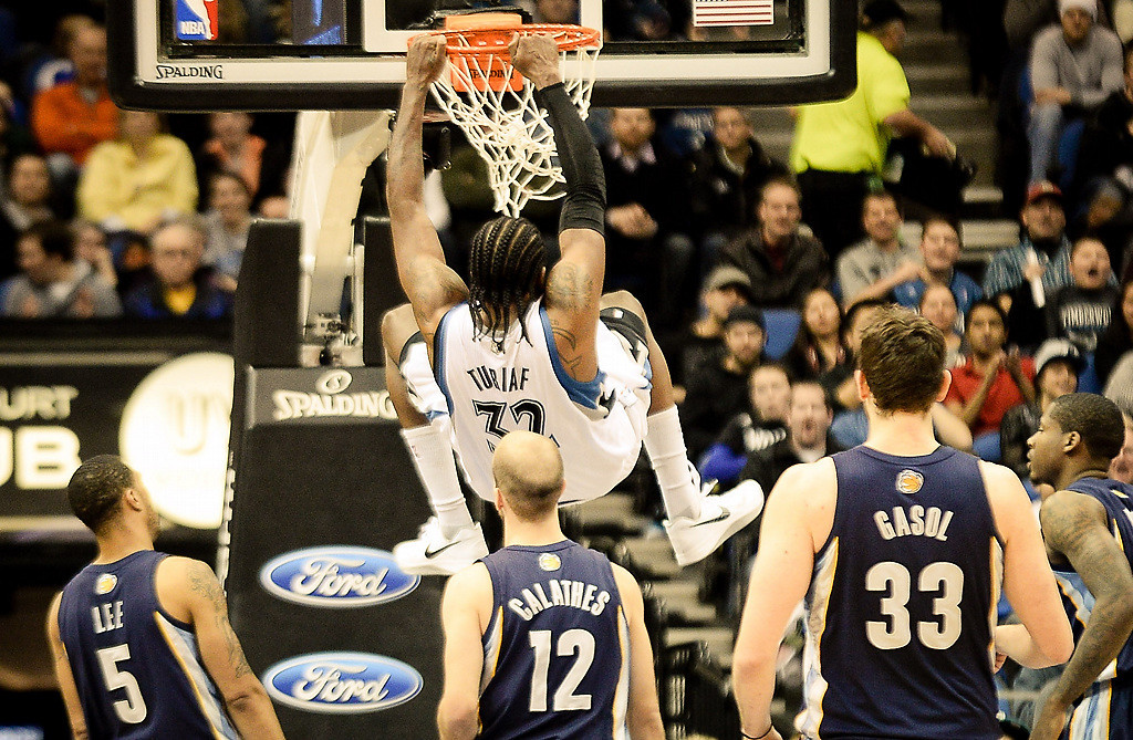 . Minnesota Timberwolves center Ronny Turiaf finishes off a dunk in the second half. Grizzlies won 94-90. (Pioneer Press: Ben Garvin)