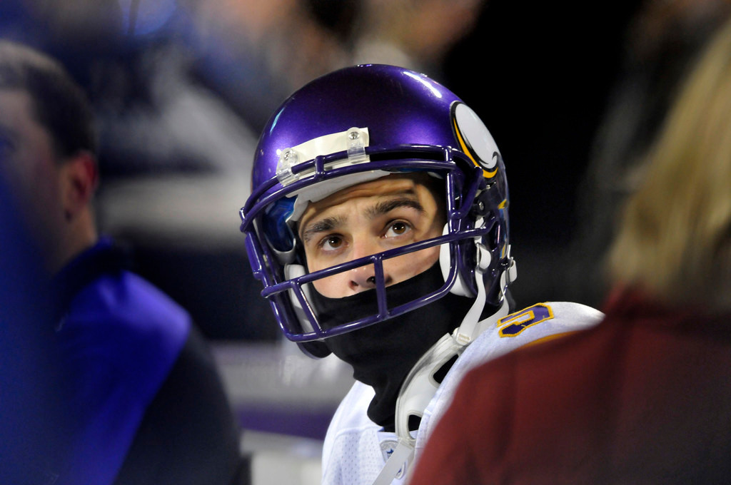 . Vikings punter Chris Kluwe stays warm on the bench prior to Minnesota\'s game against the Panthers in Charlotte, N.C. on Sunday Dec. 20, 2009.  (AP Photo/Mike McCarn)