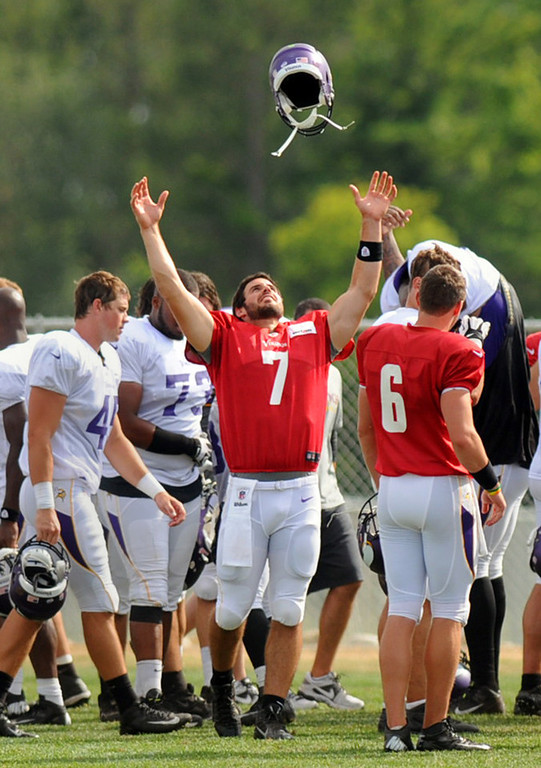 . Vikings quarterback Christian Ponder tosses his helmet in the air at the conclusion of training camp.  (Pioneer Press: Chris Polydoroff)