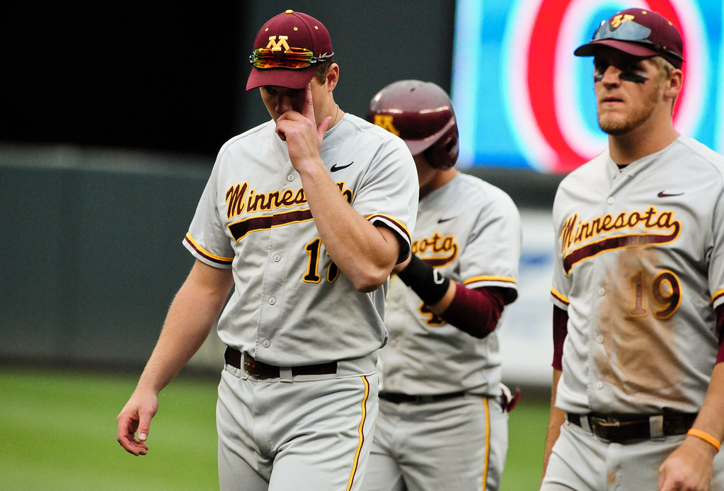. From left, Minnesota\'s JT Canakes, Connor Schaefbauer and Ryan Abrahamson walk off the field after losing 7-4 to Nebraska in the Big Ten championship baseball tournament at Target Field in Minneapolis on Friday, May 24, 2013. (Pioneer Press: Ben Garvin)