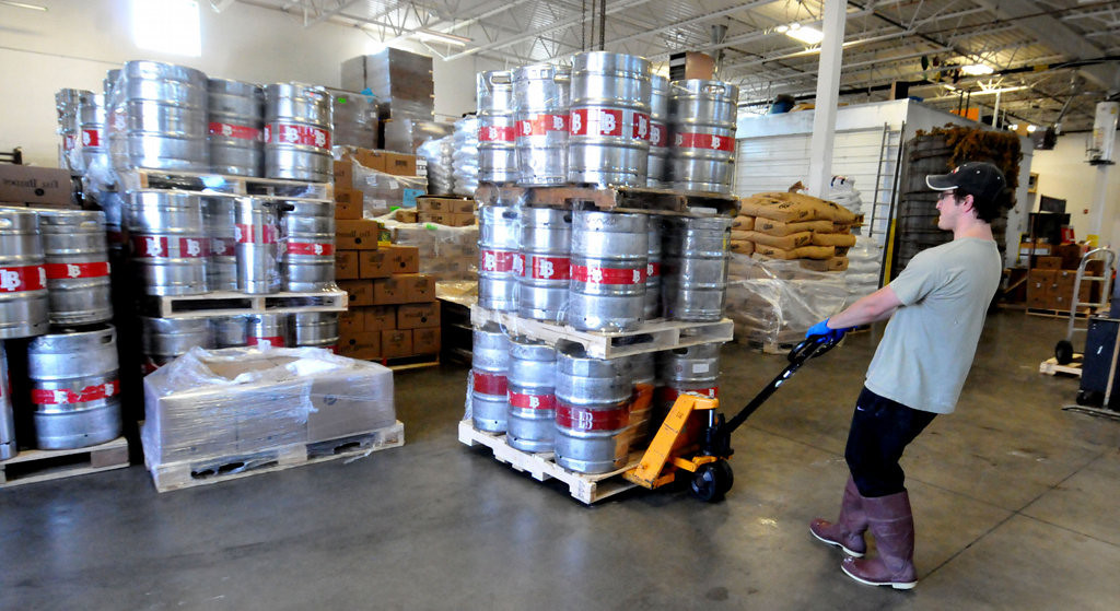 . Cellar man Adam Weis brings out empty kegs in preparation for the start of the kegging process at Lift Bridge Brewery. (Pioneer Press: John Doman)