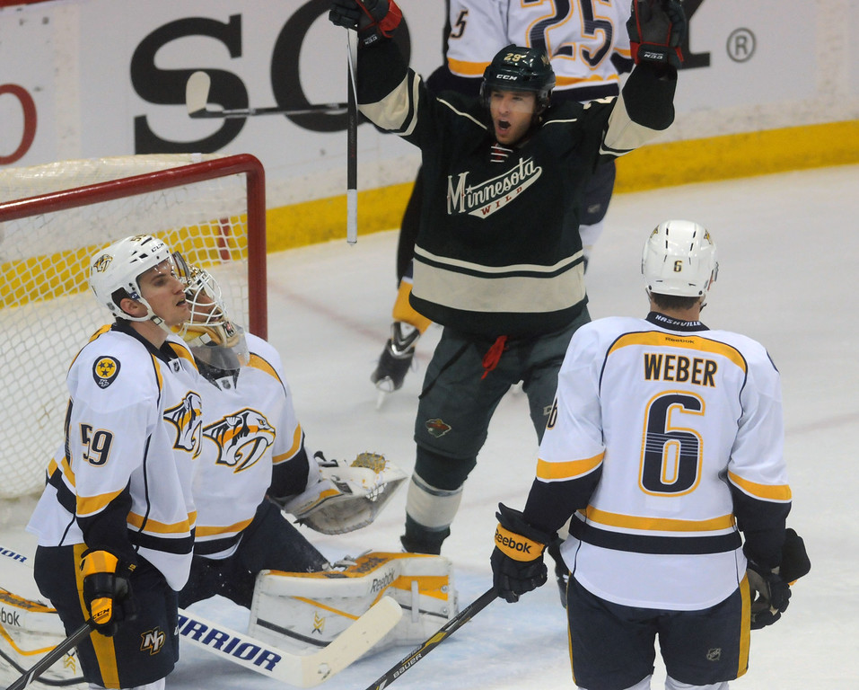. Jason Pominville celebrates his first period goal, and his 30th goal of the season, against Nashville\'s Roman Josi,left, goalie Carter Hutton, and Shea Weber, right, as the Minnesota Wild played their last game of the season against the Nashville Predators.  (Pioneer Press: Scott Takushi)