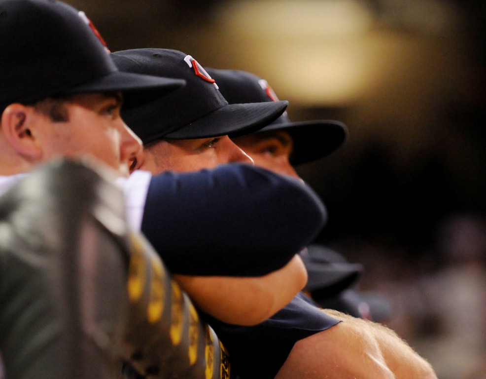 . A line of Twins stand at the rail watching as the team starts a ninth-inning rally. (Pioneer Press: John Autey)
