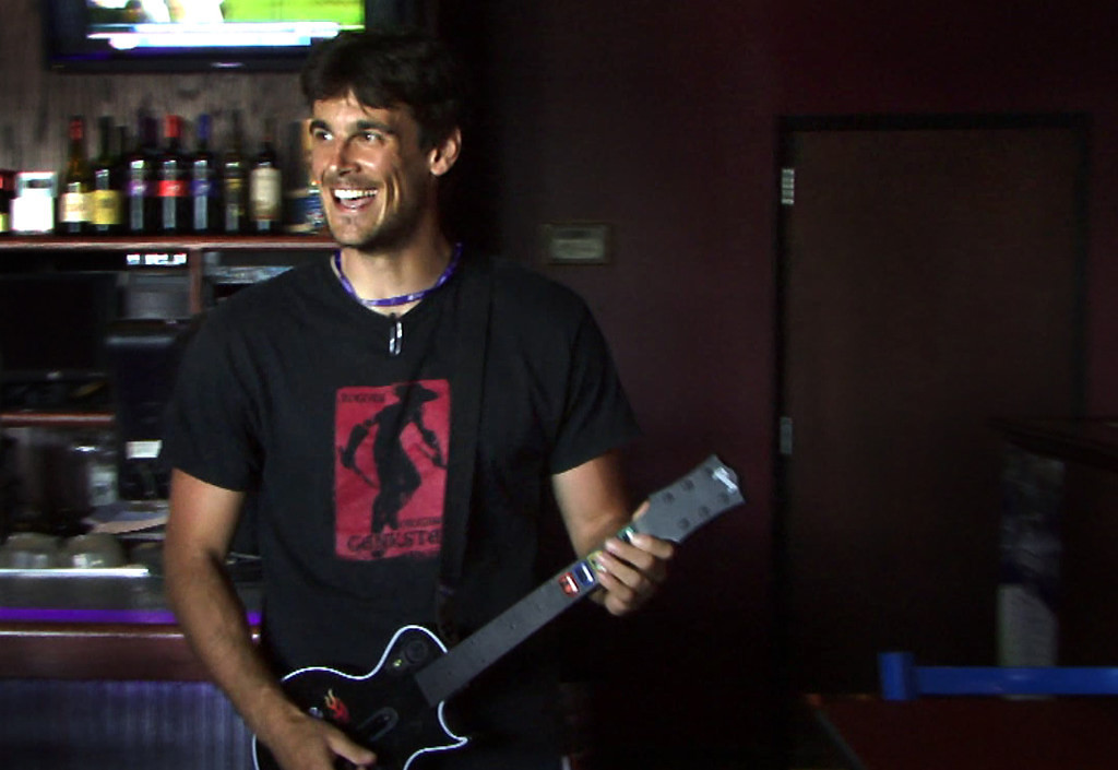. Vikings punter Chris Kluwe plays the video game Guitar Hero at Johnny B\'s bar in Mankato on August 1, 2008.  (Pioneer Press: Ben Garvin)