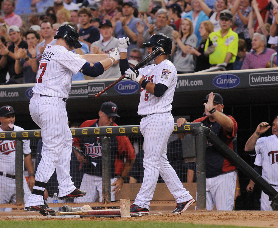 . Minnesota right fielder Chris Parmelee, left, is congratulated after hitting a solo home run off New York starting pitcher Andy Pettitte during the sixth inning. (Pioneer Press: John Autey)