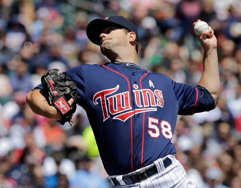 . Twins starting pitcher Scott Diamond throws against the Orioles in the first inning. (AP Photo/Jim Mone)