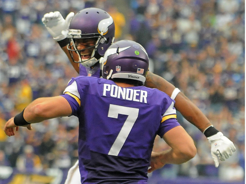 . Vikings quarterback Christian Ponder celebrates with teammate Joe Webb after Ponder\'s 8-yard touchdown keeper during the third quarter against the Browns. (Pioneer Press: Sherri LaRose-Chiglo)