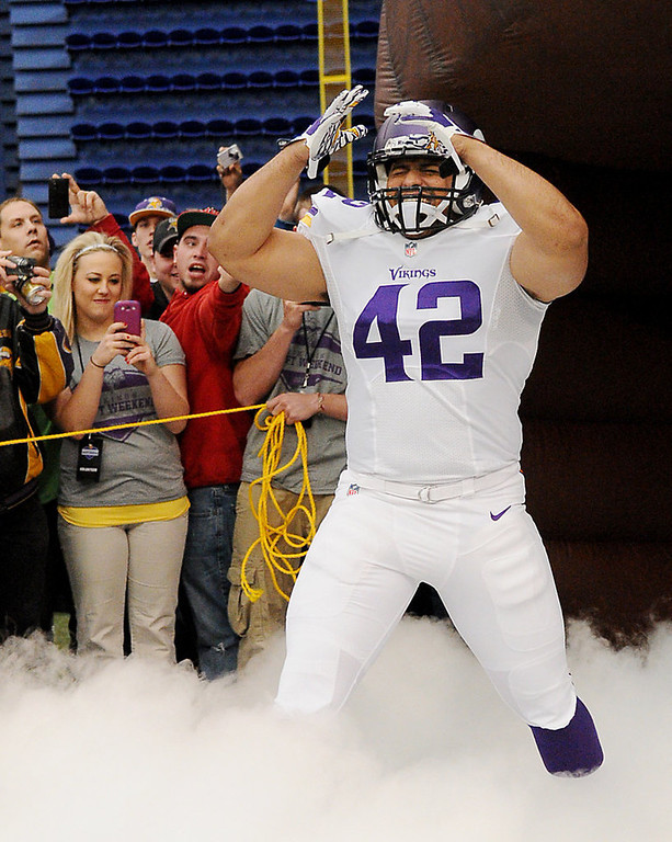. Minnesota Vikings fullback Jerome Felton models one of the new away uniforms. (Pioneer Press: John Autey)