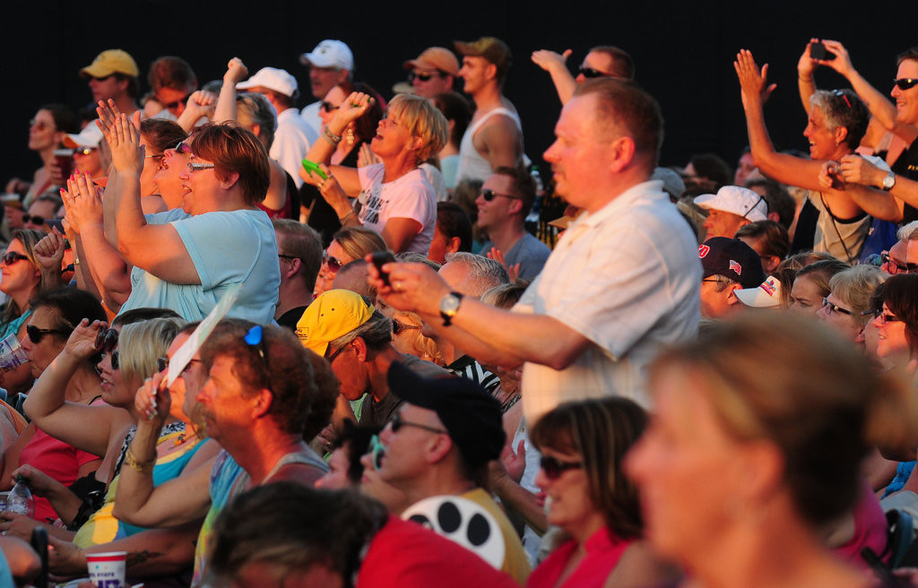 . Fans  cheer as Dwight Yoakam and his band  take the stage at the Minnesota State Fair Grandstand Sunday night. (Pioneer Press: Scott Takushi)
