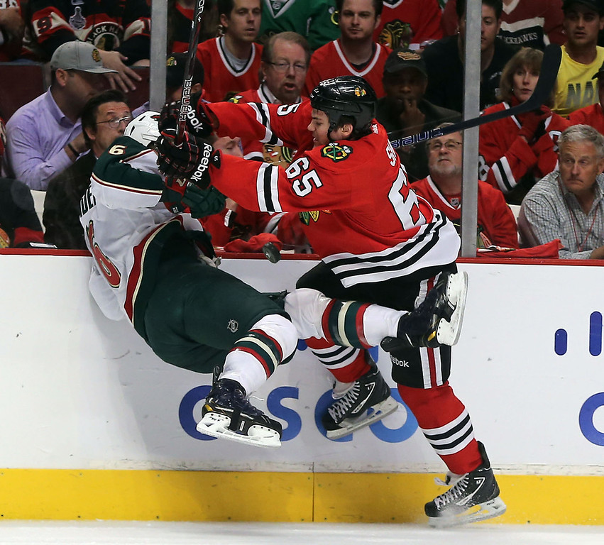 . The Chicago Blackhawks\' Andrew Shaw (65) hits the Minnesota Wild\'s Marco Scandella in the first period. (Brian Cassella/Chicago Tribune/MCT)