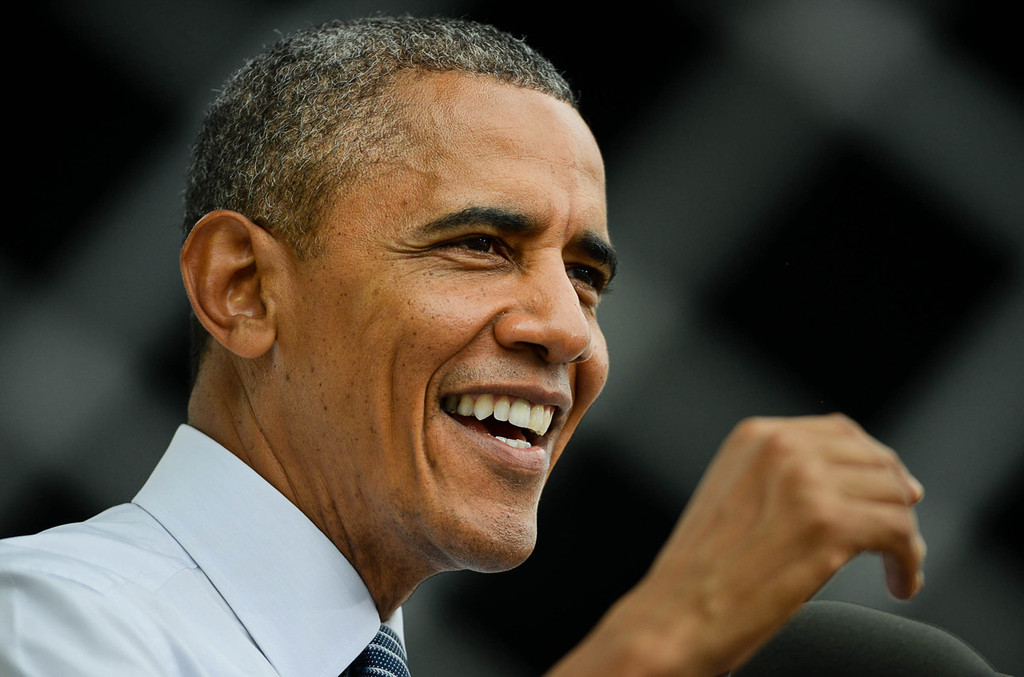 . President Barack Obama finds a light moment during his speech about economic issues. (Pioneer Press: Ben Garvin)