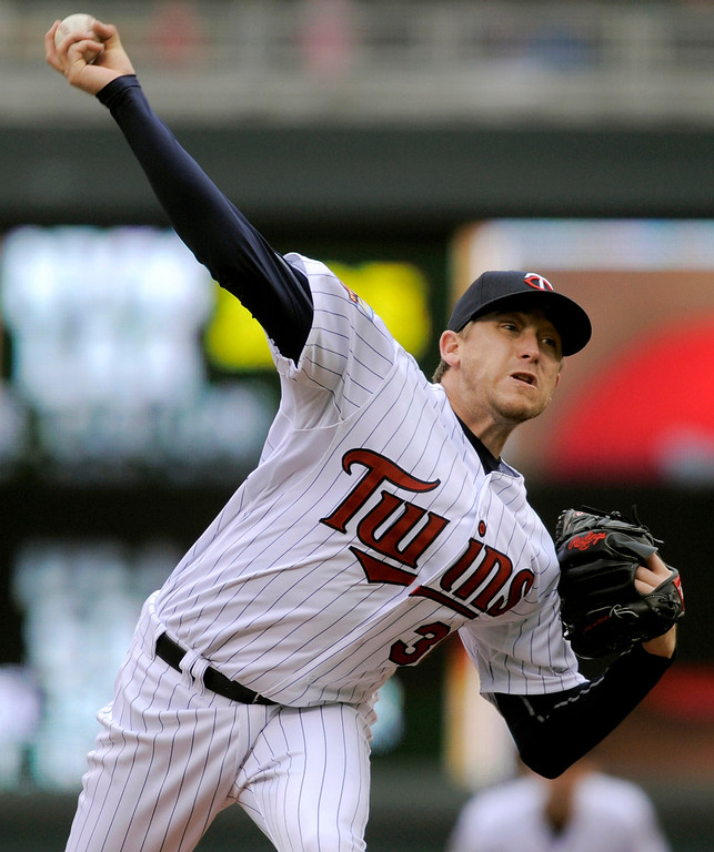 . Minnesota Twins pitcher Kevin Correia throws against the Kansas City Royals during the first inning. (AP Photo/Tom Olmscheid)