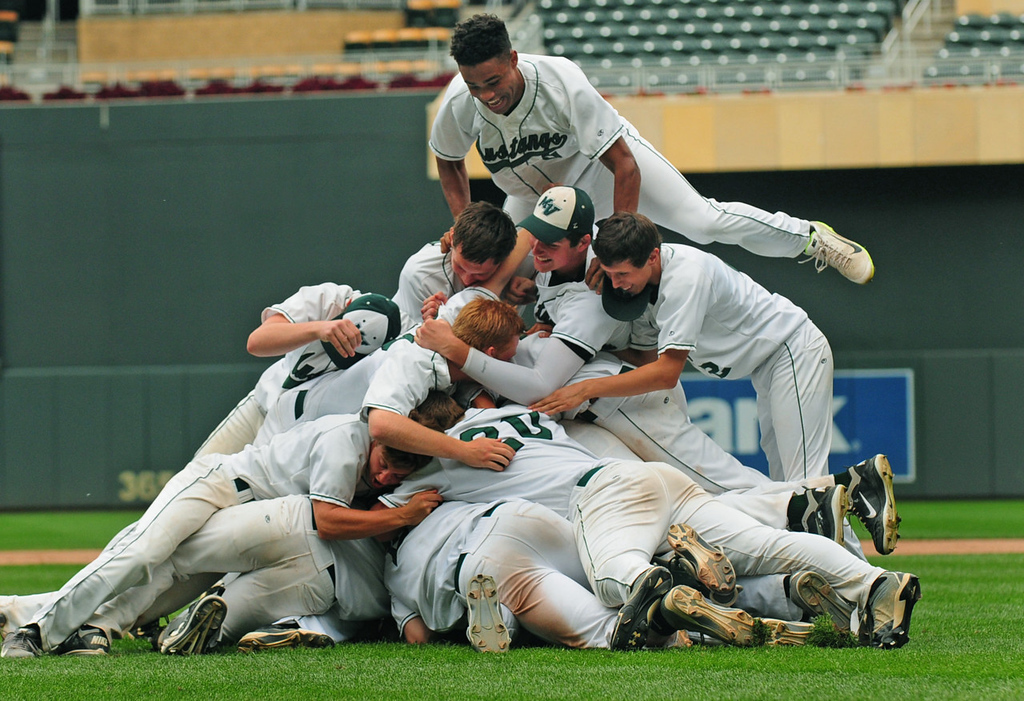 . Mounds View players, including Alec Abercrombie, top, pile on each other after their win.  (Pioneer Press: Scott Takushi)