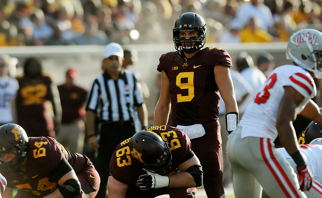 . Minnesota quarterback Philip Nelson calls out a play during the first quarter. (Pioneer Press: John Autey)