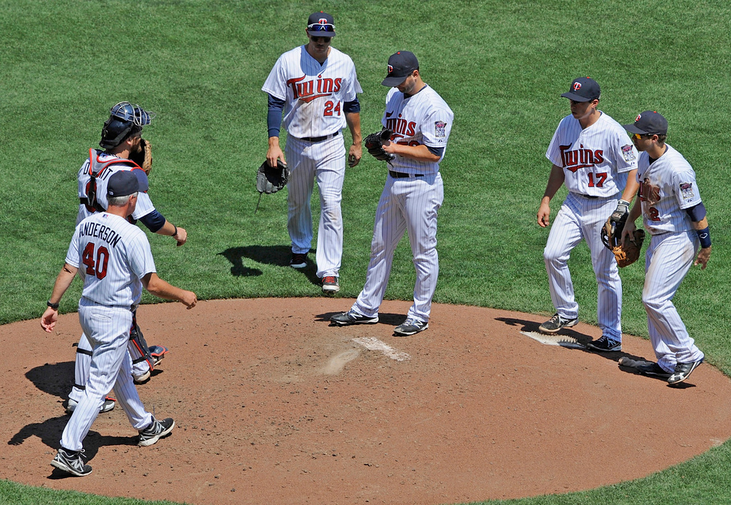 . Twins pitching coach Rick Anderson meets with starter Scott Diamond and the infield during the fourth inning against the Royals. Diamond lasted five innings, giving up seven runs (six earned) on nine hits for his 10th loss of the season. (Photo by Hannah Foslien/Getty Images)