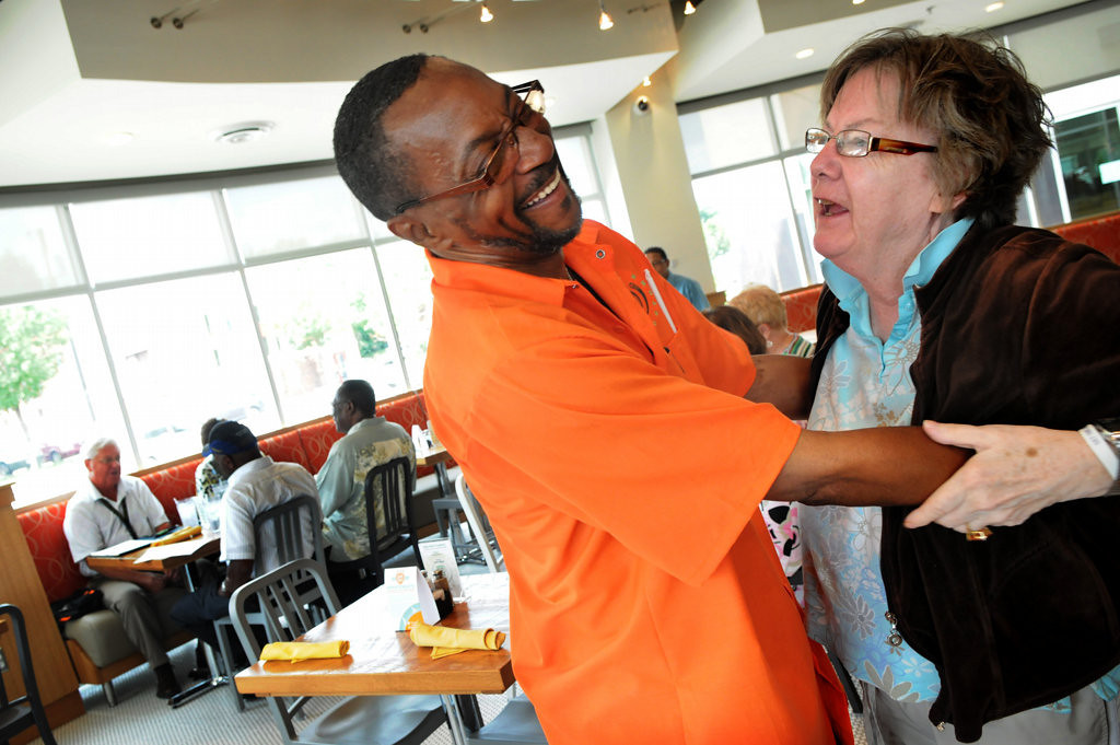 . Luanne Christensen gives Henry Wallace a hug at Frogtown\'s Daily Diner, the Union Gospel Mission\'s supported eatery during lunch in St. Paul on Thursday August 15, 2013. Wallace is in a culinary training program through the Our Daily Bread training program. He was homeless and jobless and Union Gospel Mission programs is offering training for a new lease on life. (Pioneer Press: Jean Pieri)