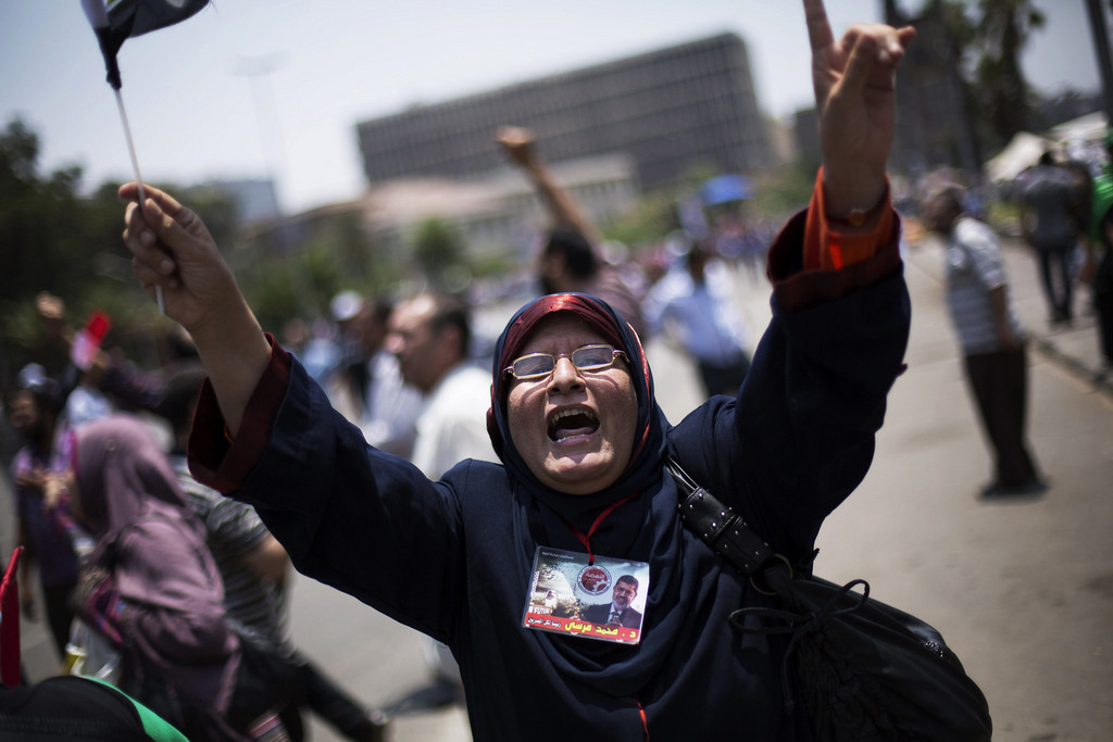 . An Egyptian woman chants slogans supporting Egypt\'s Islamist President Mohammed Morsi during a rally near Cairo University in Giza, Egypt, Tuesday, July 2, 2013.  (Associated Press: Manu Brabo)