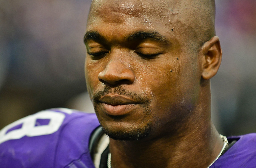 . Glum Vikings running back Adrian Peterson heads off the field after Minnesota\'s 31-27 loss to Cleveland. Peterson was held to 88 yards on 25 carries in the game. (Pioneer Press: Ben Garvin)