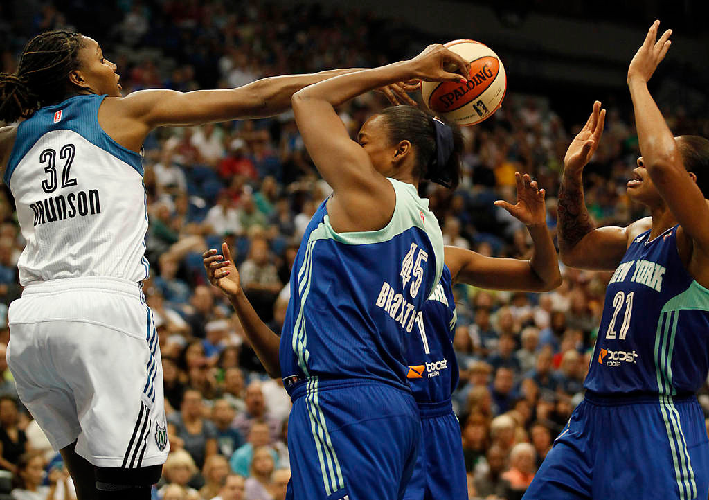 . Minnesota Lynx forward Rebekkah Brunson tries to grab a lose ball against New York Liberty forward Kara Braxton in the second half. (AP Photo/Stacy Bengs)