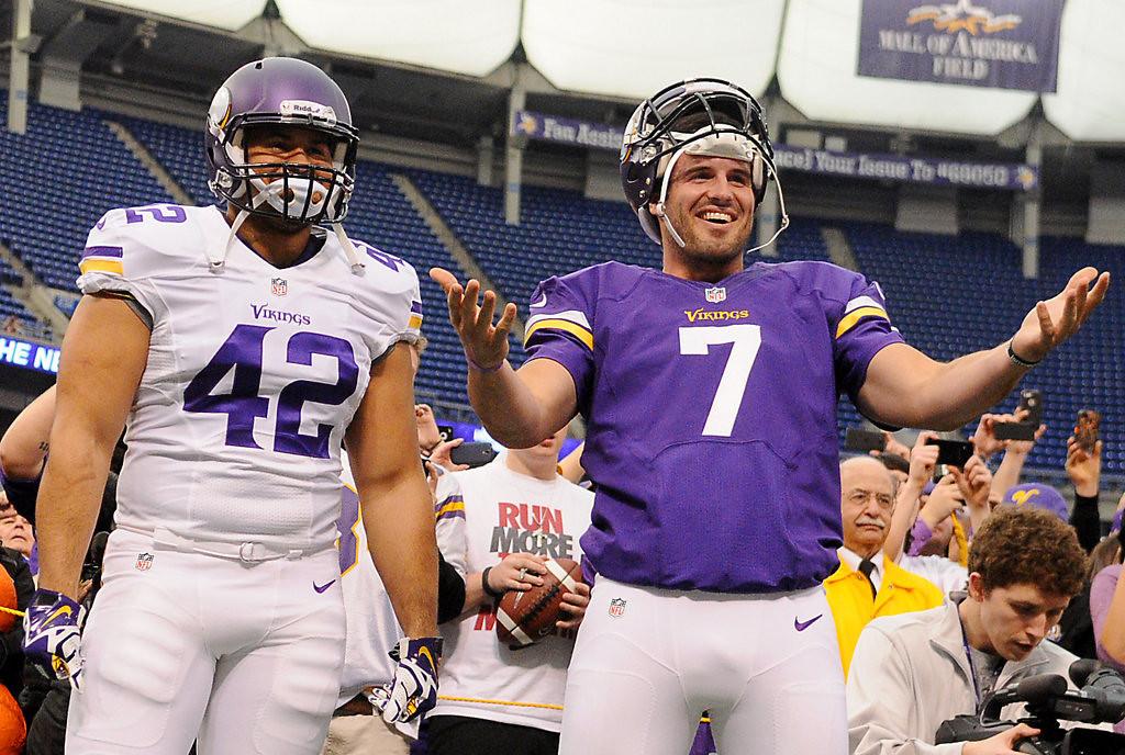. Minnesota fullback Jerome Felton and quarterback Christian Ponder model the Vikings\' new uniforms. (Pioneer Press: John Autey)