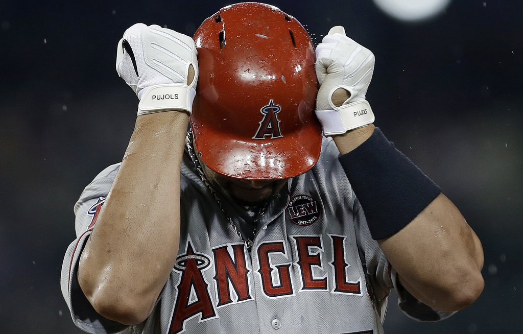 """. <p><b> Things got bleaker for Los Angeles Angels fans this week when they learned former MVP Albert Pujols is � </b> <p> A. Done for the season  <p> B. Done playing first base  <p> C. Done  <p><b><a href=\'http://sportsillustrated.cnn.com/mlb/news/20130819/angels-albert-pujols-done-for-year.ap/?sct=hp_t2_a11&eref=sihp\' target=\""""_blank\"""">HUH?</a></b> <p>    (AP Photo/Paul Sancya, File)"""