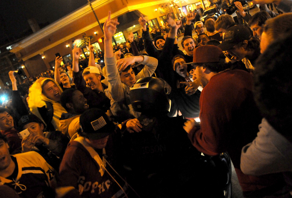 . U of M fans surround a motorcyclist at the intersection of 14th and 4th in Dinkytown as the riot began..(Pioneer Press: Sherri LaRose-Chiglo)