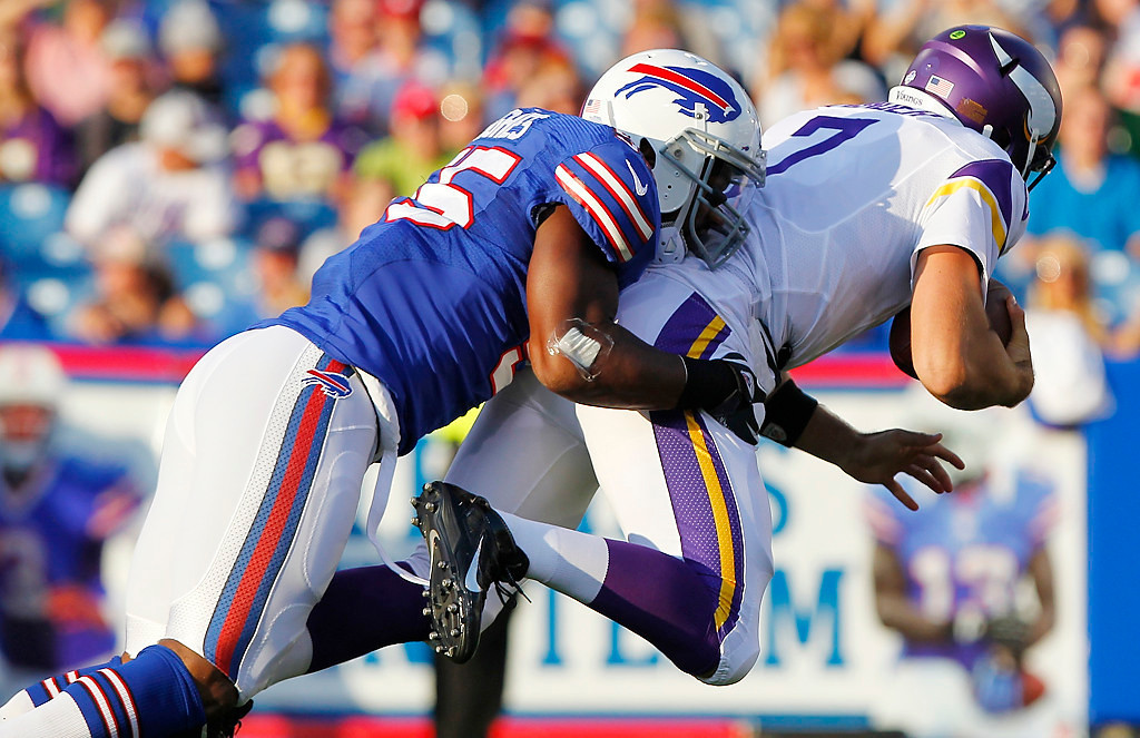 . Buffalo Bills\' Jerry Hughes (55) sacks Minnesota Vikings quarterback Christian Ponder (7) during the first half of an NFL preseason football game Friday, Aug. 16, 2013, in Orchard Park, N.Y.  (AP Photo/Bill Wippert)