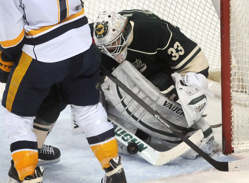 . The Wild\'s John Curry makes a save  in the third period as the Minnesota Wild lost 7-3 in their last game of the season against the Nashville Predators.  (Pioneer Press: Scott Takushi)