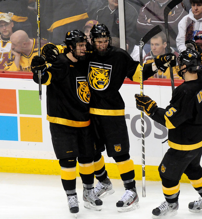 . Colorado College\'s Alexander Krushelnyski, left, Charlie Taft, middle, and Aaron Harstad, right, celebrate Taft\'s second period goal during the WCHA Final Five at the Xcel Energy Center Arena on March 22, 2013. (Pioneer Press: Sherri LaRose-Chiglo)