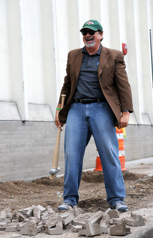 . Co-owner of the Saints Mike Veeck laughs aloud after he broke up 2 cement blocks during a site demolition. The sledge hammer was in the shape of a baseball bat. (Pioneer Press: Sherri LaRose-Chiglo)
