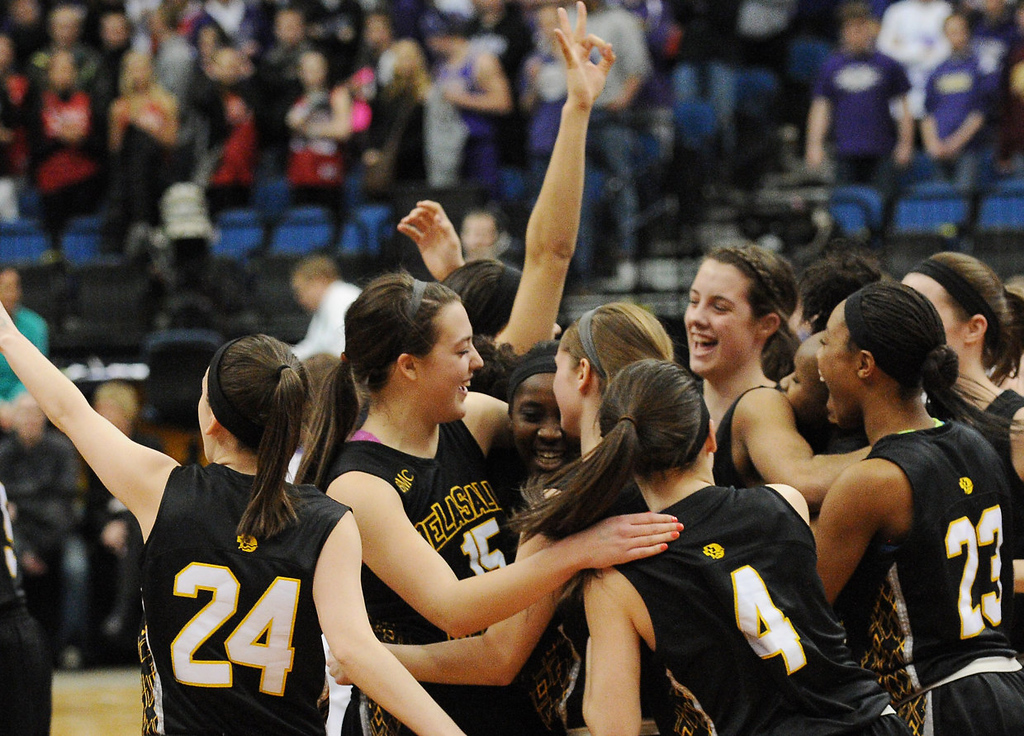 . The DeLaSalle Islanders celebrate their 65-50 victory over Red Wing Wingers to claim the Class 3A Championship in the 2013 Girls Basketball State Tournament at the Target Center in Minneapolis on Saturday, March 16, 2013. (Pioneer Press: John Autey)