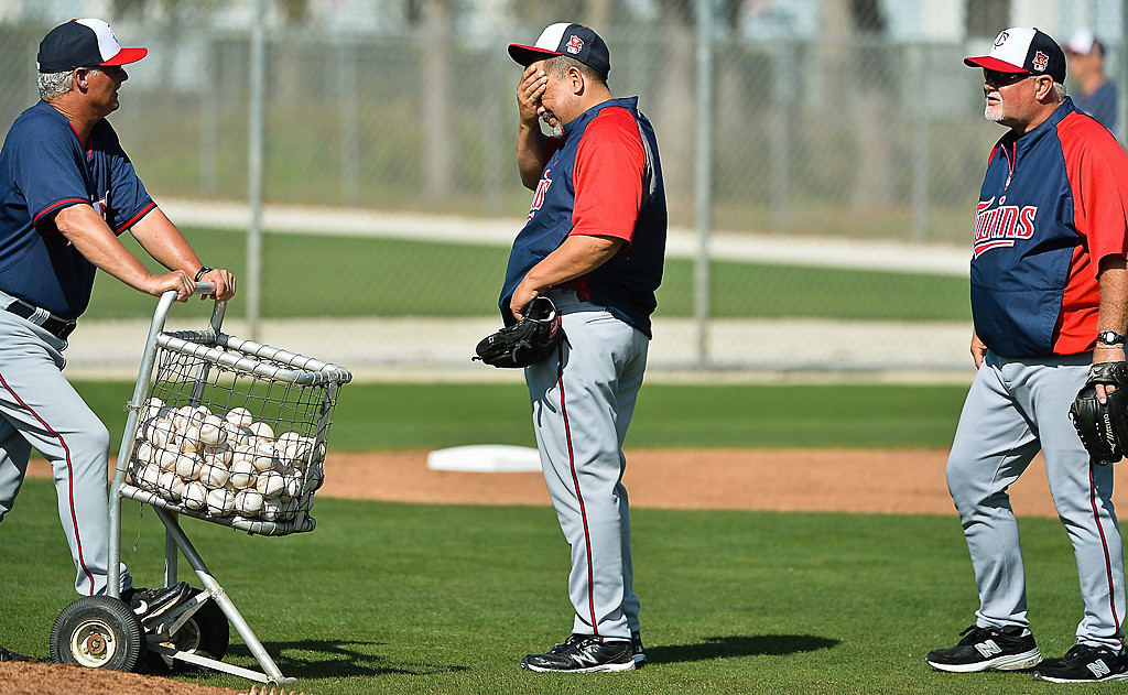 . Coaches (from left) Rick Anderson, Eddie Guardado and manager Ron Gardenhire gather balls after a drill. (Pioneer Press: Ben Garvin)