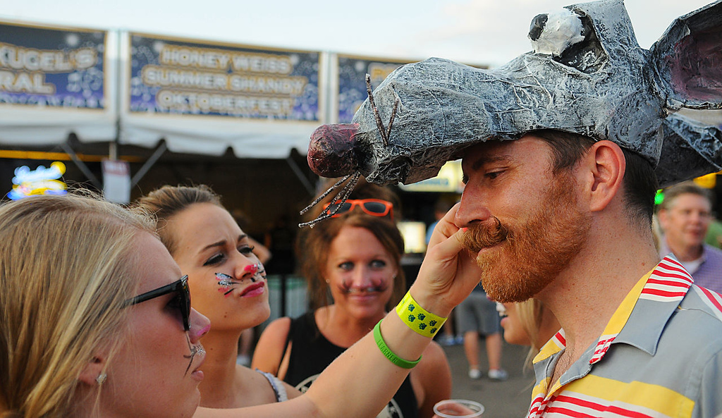 ". Kevin Kirsch, from Minneapolis, came sporting a mouse figure on his hat to the 2013 Internet Cat Video Festival presented by Walker Art Center at the Minnesota State Fair Grandstand, Wednesday, August 28, 2013 in Falcon Heights. ""Some of my best friends are cats,\"" said Kirsch as three women dress as cats \""played with him\"". (Pioneer Press: John Autey)"