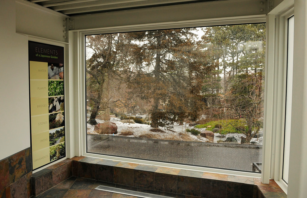 . A viewing window in the new building and landscape addition at the Ordway Gardens provides a view of the Japanese Gardens at the Como Park Conservatory. (Pioneer Press: Scott Takushi)