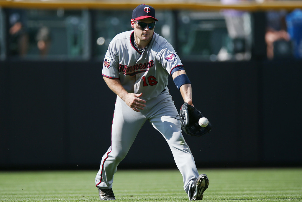 . Minnesota Twins left fielder Josh Willingham fields single of the bat of Colorado Rockies\' Justin Morneau in the seventh inning. (AP Photo/David Zalubowski)