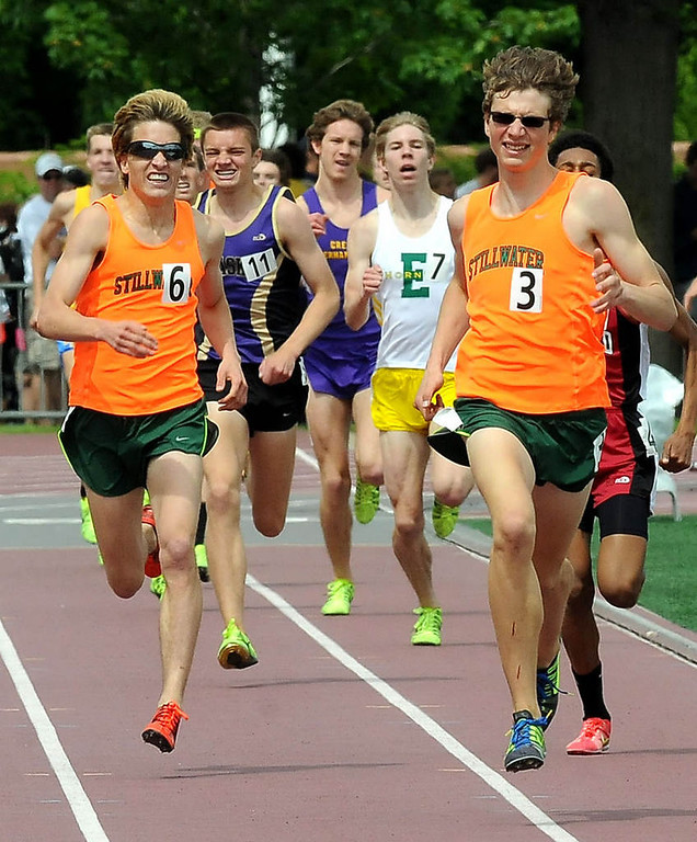 . Eli Krahn, right, and Wayde Hall, left, of Stillwater lead the pack during the 1600 meters. Krahn placed first and Hall placed second. (Pioneer Press: Sherri LaRose-Chiglo)