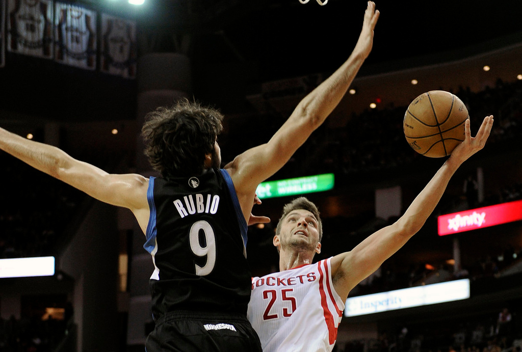 . Houston Rockets\' Chandler Parsons (25) goes to the basket against the Minnesota Timberwolves\' Ricky Rubio (9). (AP Photo/Pat Sullivan)