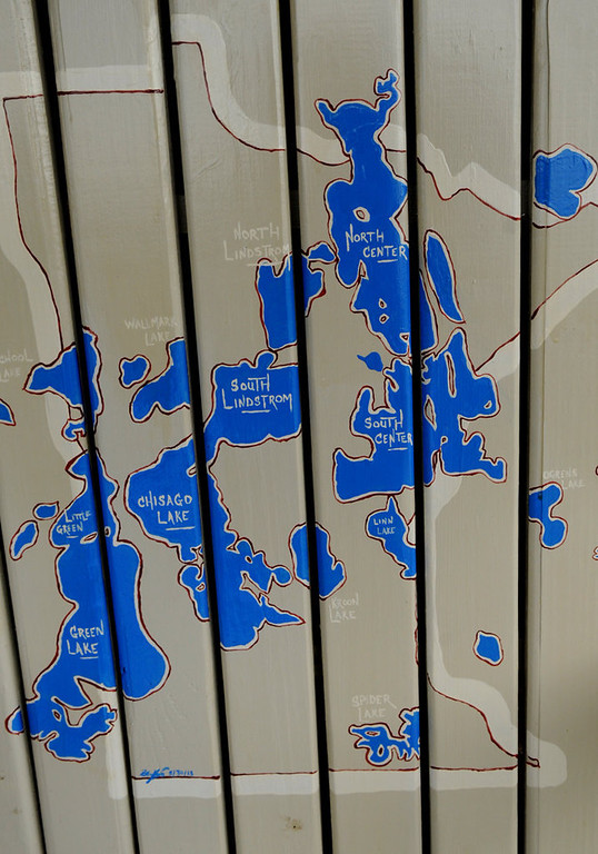 """. A close-up of the \""""Chain of Lakes\"""" in Minnesota is seen on the  back of an adirondack chair painted by  Boe Krick.  (Pioneer Press: Jean Pieri)"""