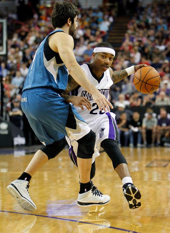 . Sacramento Kings guard Isaiah Thomas (22) drives against Minnesota Timberwolves defender Ricky Rubio during the second half. (AP Photo/Steve Yeater)