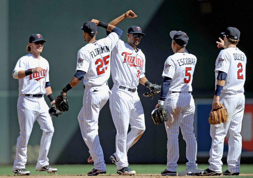 . Twins players (from left) Chris Herrmann, Pedro Florimon, Aaron Hicks, Eduardo Escoba and Brian Dozier celebrate their 10-0 pasting of the Mariners on Sunday. (Photo by Hannah Foslien/Getty Images)